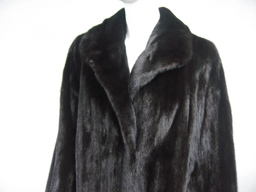 Almost Black on this wonderful soft supple Louis Feraud Mink Coat. Has a bit of a swing to it. French Hem, only the best on this luxurious mink Coat. Large Hallmarked Feraud button way up on the neckline to keep you toasty warm, then clips down the