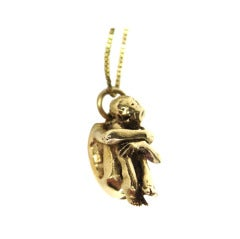 "Gold Crouched Woman Necklace ""Fetal Position"""
