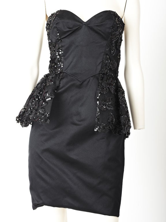 Vicky Tiel, black satin, strapless cocktail dress with sides, back, and peplum  of black sequins on tulle detail.