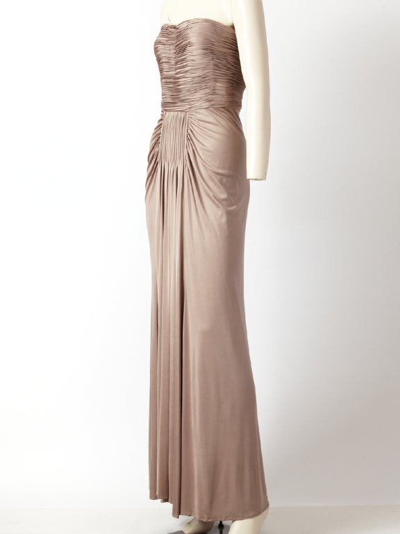 Oscar de la Renta, oyster grey, matte jersey, Grecian inspired gown with flutted detail at the bodice, hips and center front waist.Beautiful draping technique.