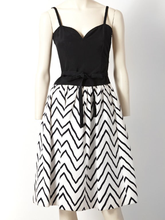 YSL, black and white graphic print dress. Fitted bodice has thin straps and is made of black faille with a thin self belt that ties.