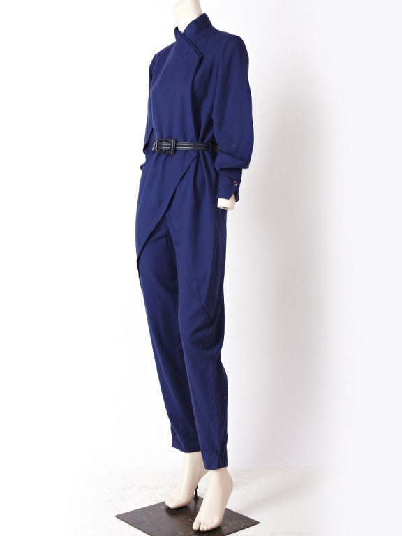 """Ronaldus Shamask, navy blue, gaberdine jumpsuit with an Asian inspired silhouette. Mandarin collar with a side closure and a """"spiral"""" panel detail on the right hip."""