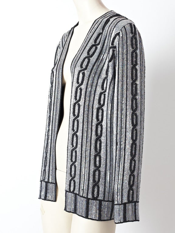 Carolyne Roehm, silver grey, beaded evening cardigan with vertical, navy blue cable pattern and stripe detail.