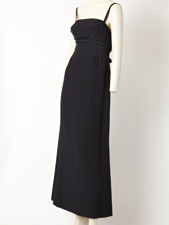 Pauline Trigere, silk crepe, empire waist, A line gown with spaghetti straps, open back with bow detail.