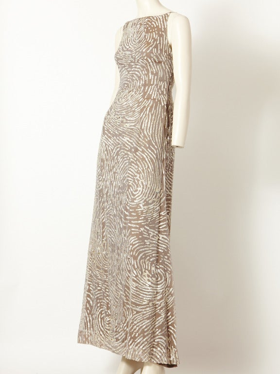 Oscar de la Renta, taupe colored, chiffon,gown with a bateau neckline, and a spiral, silver sequin overall pattern embellishment.