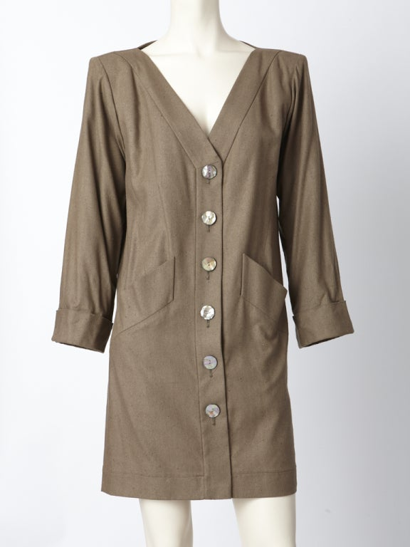 "YSL, taupe tone, raw silk, chemise style, v neck, day dress that buttons up the frond. Interesting ""pleated"" center back detail.  Circa 1980's."