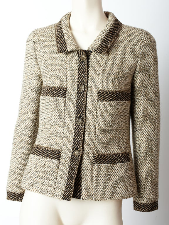 Chanel, slightly fitted tweed jacket with breast and hip pockets and collar. Tones of toast, taupe and ivory.