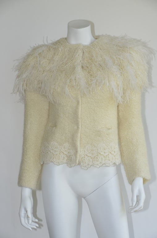 Nina Ricci presents a dramatic take on the cropped tweedy jacket. Look 19 from the Nina Ricci Pre-Fall 2011 presentation. Natural (ivory) fuzzy mohair-blend knit with white oversize ostrich feather collar extending over shoulders. Round neckline;