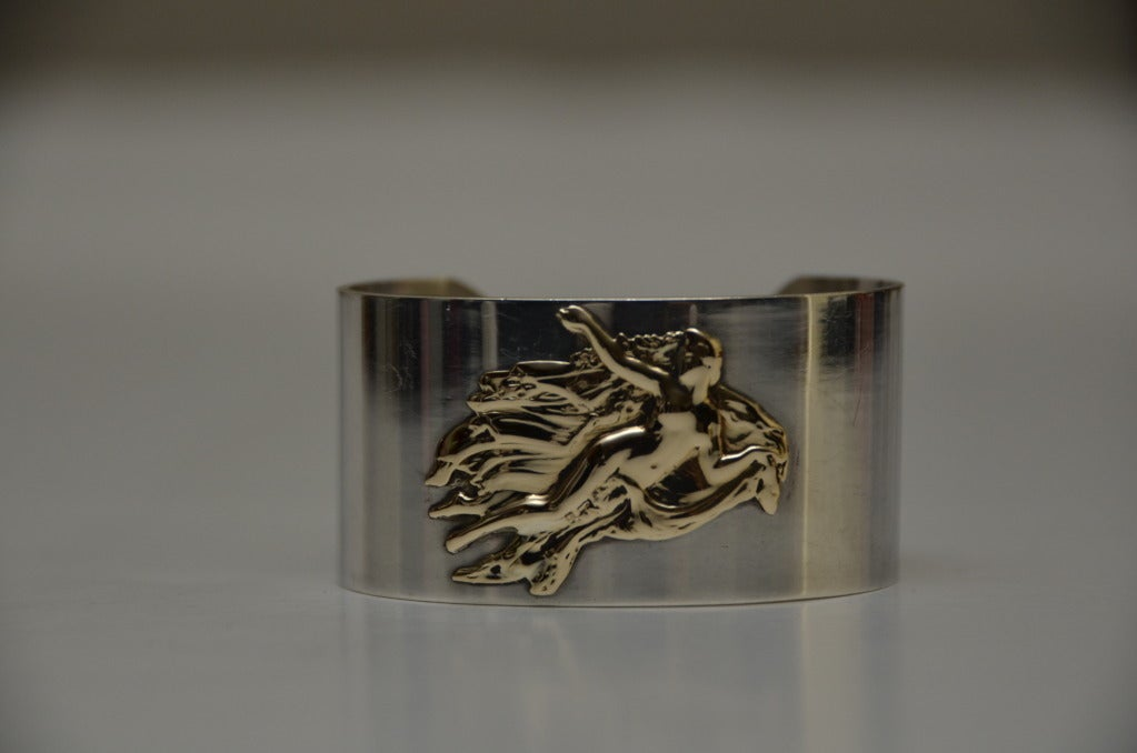 Vintage PIERRE CARDIN Aphrodite Goddess Of Love Rare Bracelet .Vintage 60' Pierre Cardin  large cuff made from sterling silver with a 14k gold  Aphrodite adorning the front. Truly gorgeous piece, right on trend and an amazing collectors item.