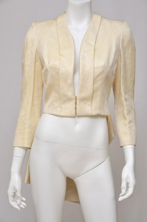 Alexander McQueen Jacket Tailcoat  Runway '07.Size 42Fr. Made in Italy.Very beautiful bolero with hook fastening in the front and tail in the back.Very much Alexander McQueen signature style.Excellent condition.Brocade print fabric.Off white color