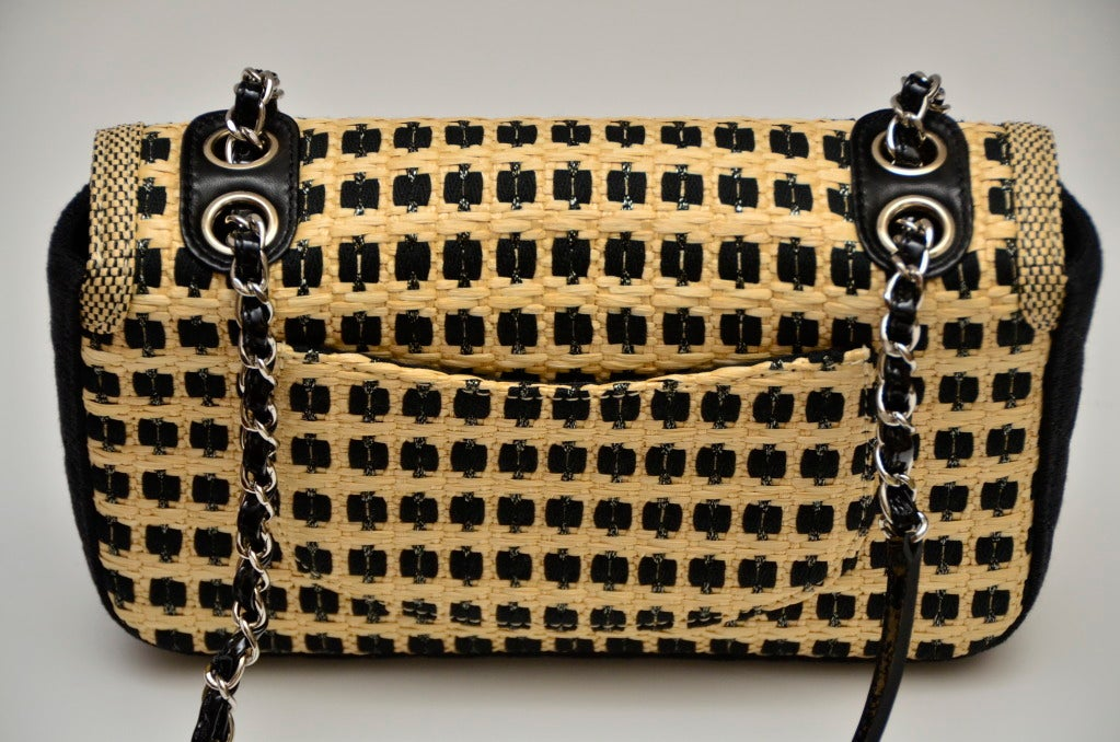 2012 CHANEL Black Beige Straw Raffia with Metallic Threading 2.55 Chain Flap Bag.Gold & Silvertone Mademoiselle 2.55 Closure Beautiful Straw Detail Pattern Quilted Black Fabric on Sides & Bottom of Bag.Silvertone Hardware Black Patent Leather &