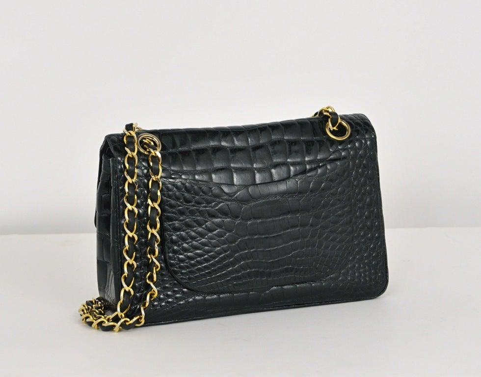Classic Chanel double flap 2.55 in saturated black crocodile skin with leather and chain strap. Superb!