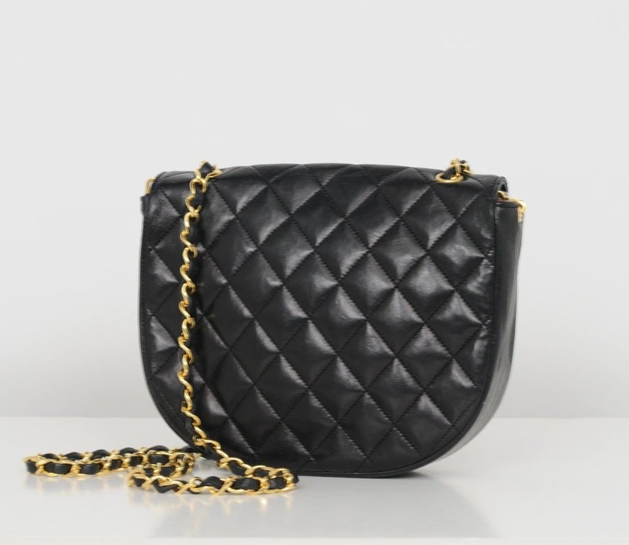 Black lambskin quilted cross body pouch bag with large CC snap closure & single leather and chain strap.