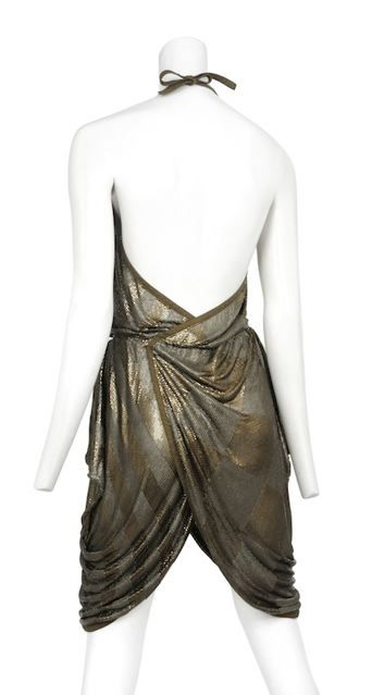 Early Versace iconic metal mesh cocktail dress with leather neckline and trim. Avant- garde angular hip detailing with the metal mesh cascading to hem.