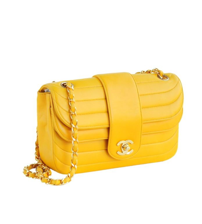 Canary yellow leather double flap Chanel handbag with horizontal quilt stitching and double chain and leather strap.