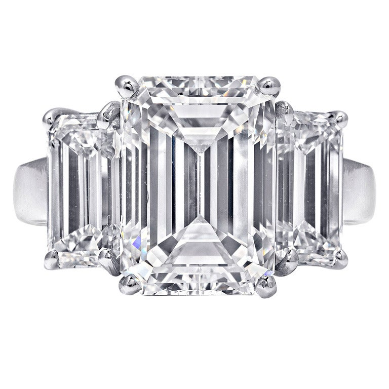 Three Stone 7 Carat Emerald Cut Ring at 1stdibs