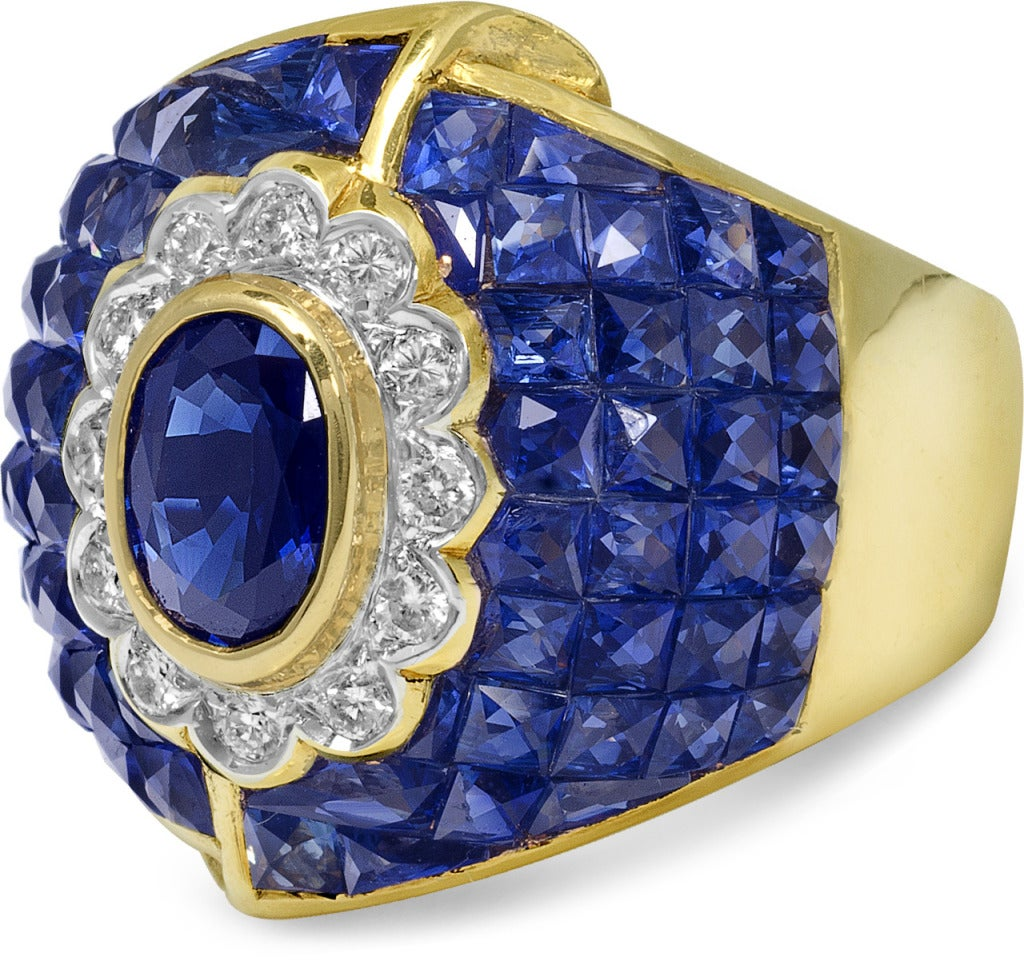Set in 18k yellow gold these sapphires really shine bright.  The ring sits large and yet very comfterable.  For those who truly like blue this is your ring.  The diamonds were only inserted to complement the sapphire, this is a true sapphire bombe
