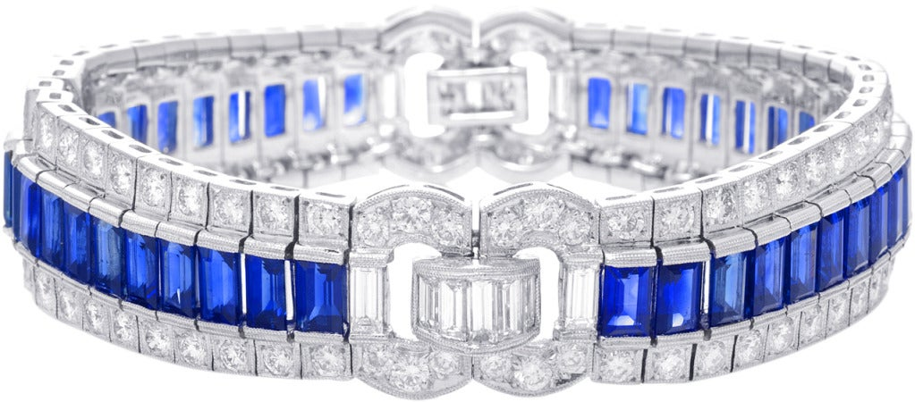 This bracelet has amazing flow.  The sapphires get taller towards the front.  On the sides they taper to allows for detailed design which  also serves as a hinge that allows the bracelet to sit gently.