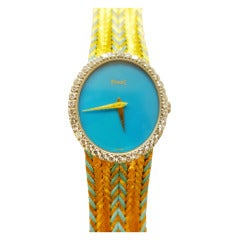 Piaget Lady's Yellow Gold and Diamond Bracelet Watch with Turquoise Dial