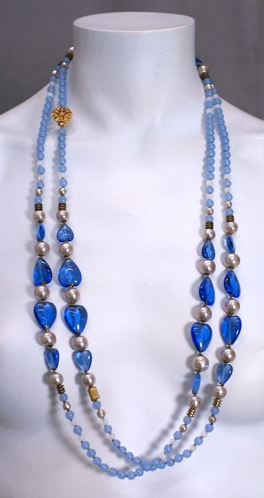 Miriam Haskell long bead necklace of varied shades of blue pate de verre beads in round and heart shapes with baroque pearl and gilt metal spacers. USA 1950s<br /> Excellent condition.<br /> <br /> 64