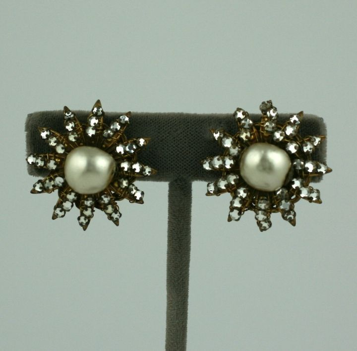 Miriam Haskell pearl earrings with rose monte paste accents sewn by hand. Simple and striking. 1940s USA.<br /> Adjustable clip back fittings. Signed Miriam Haskell. 1