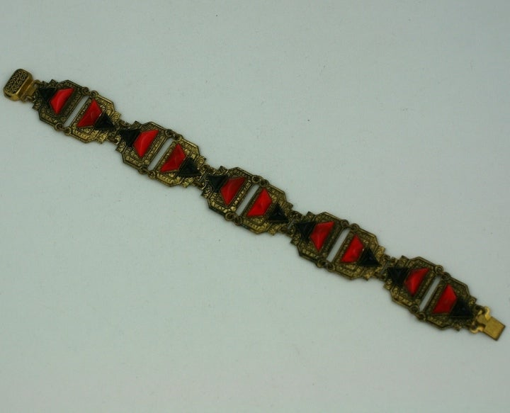 High style deco bracelet of red and black cut glass stones on ornately engraved links. Czech 1930s.  Excellent condition.