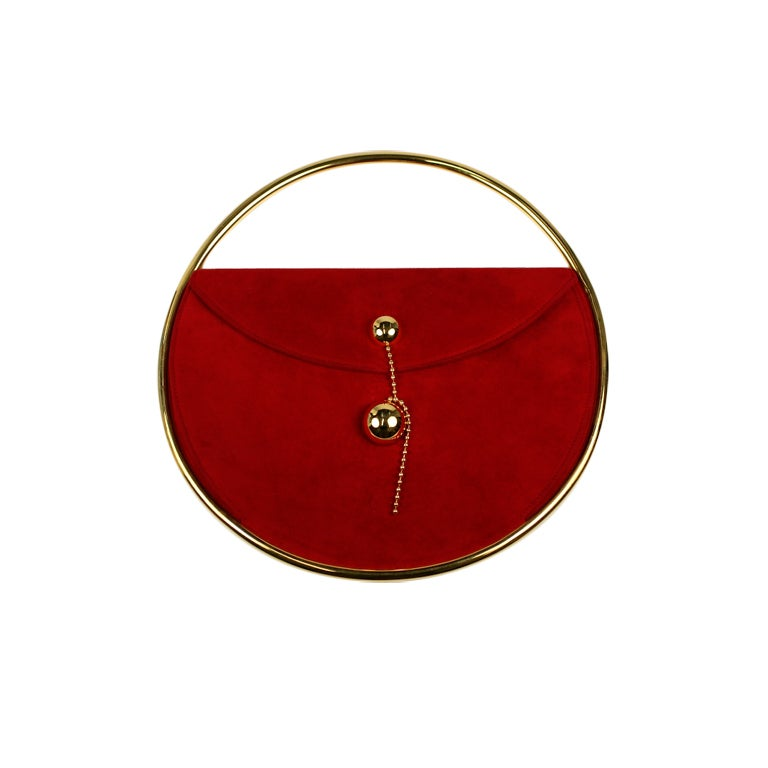 An Escada Red Suede and Silk Handbag, with goldtone hardware, a suede and double goldtone chain shoulder strap, an exposed top zip closure and two interior pockets. Together with a dust bag. Together with a dust bag.