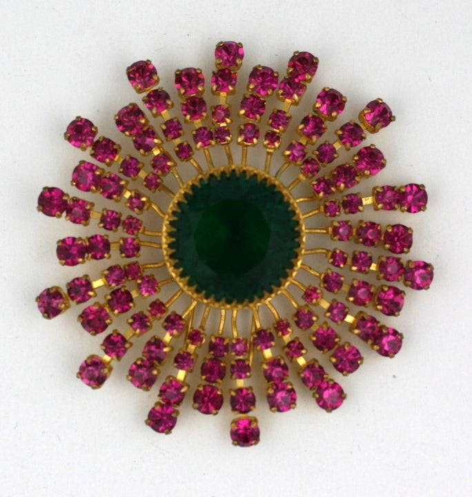 Rare signed  Countess Cis fushia and emerald Swarovski crystal sunburst clip brooch mounted in gilt bronze.  Countess Cis born in Vienna, she started her career in jewelry in 1951 by hand-painting cufflinks and buttons.  She was quickly taken up