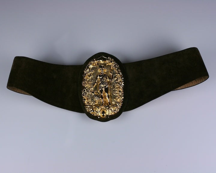 """Unusual high relief belt with gilt plaque of Diana the huntress on an adjustable curved suede belt. Belt is 5"""" wide in front and fits 24"""" to 32"""". Hook closure in front. Leather lined. 1980s USA. Excellent condition."""