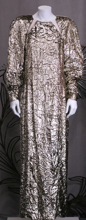 Silvery gold crushed velvet gown by Hanae Mori, Paris. Unusual sheer mesh inserts on raglan lines with large padded round shoulders. 1980s France. Length 56