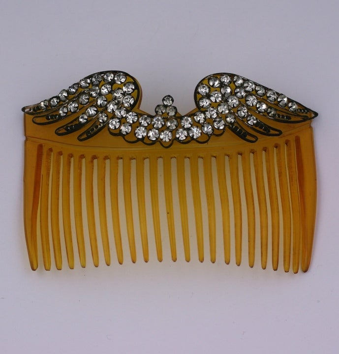 Edwardian faux tortoise celluloid large hair comb, mounted with paste set silver gilt bird wings. Made in France circa 1900.