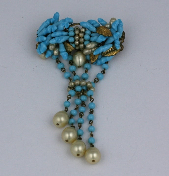 Delicate example of Louis Rousselet's masterful treatment of pate de verre techniques as seen in the turquoise glass pistils and signature pearls of this period brooch. 1930's France. Excellent condition. 1.5