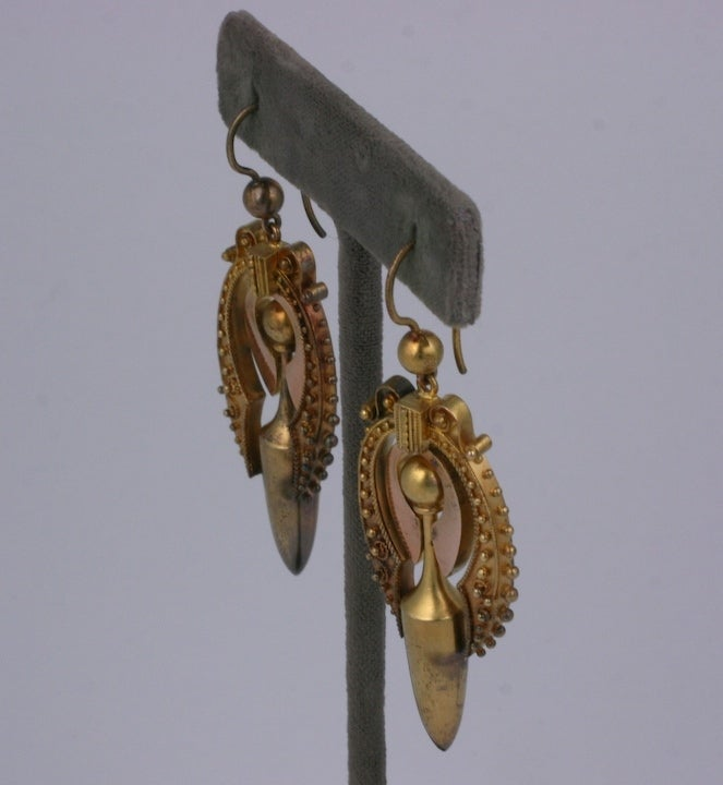 Victorian urn earrings with etruscan work rendered in 2 tones of gold. In original condition with period ear wires. Beautiful quality circa 1880s USA. Excellent condition.2.25