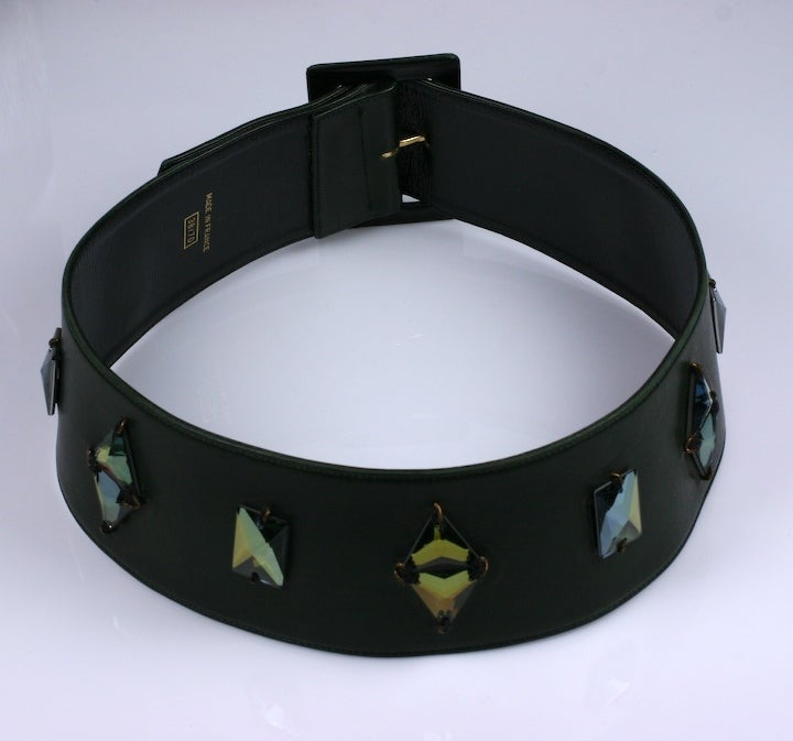 Deep olive calf belt from the late 1980's with leather self covered buckle and aurora Swarovski triangular crystals applied. Belt is cut on the round so it molds to waist and upper hip slightly. Adjustable from 26.5