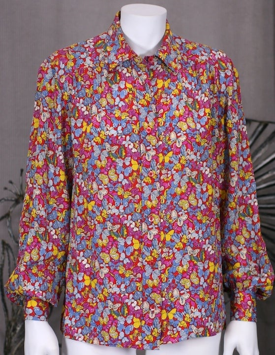 Celine forever celebrates the Bon Chic Bon Genre style of classical Parisian girl prettiness. Classic man cut shirt in silk jacquard scattered with multicolored butterfiles on a hot pink ground. 1970s France. Excellent condition. Size 38 Eu.