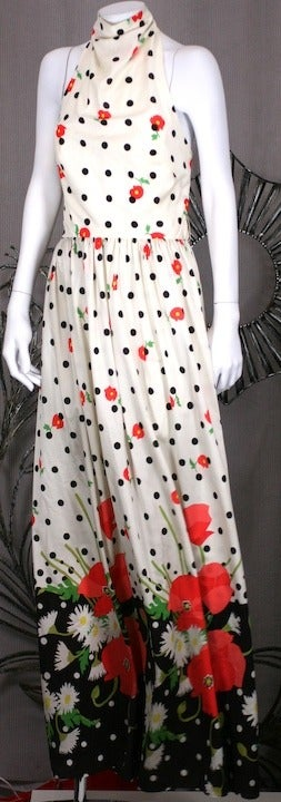 Charming Oscar de la Renta Poppy Print Halter dress in synthetic knit with large floral border. 1970s USA.  Size 12 vintage/6-8 Contemporary. Waist 26