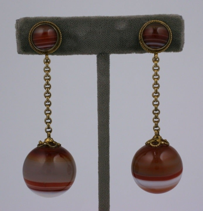 Lovely mid Victorian earrings of Scottish striped agate in a simple drop formation. Timeless elegant design set in gilt metal with a cabochon agate at the ear. The chain is a rich double link which works nicely with the twisted wire borders. Nice