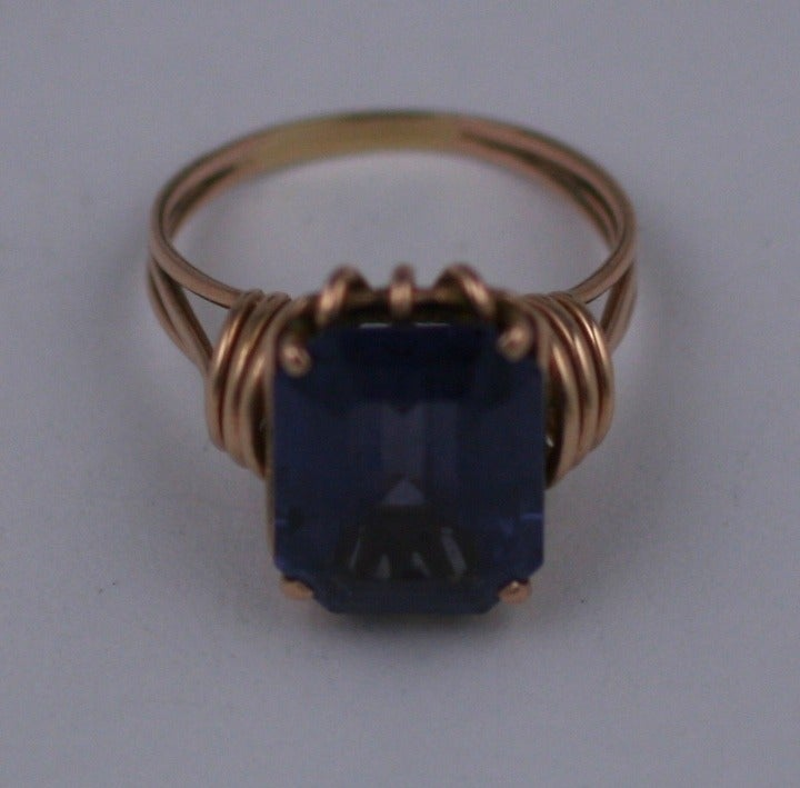 Lovely Retro ring of 14k pink gold wires in a handmade setting for a deep amythest emerald cut stone. The wire work is symmetrical and forms a perfect nest to support the stone. Amythest: 15 mm x 12 mm approx 6 carats. Ring size 10. 1940's