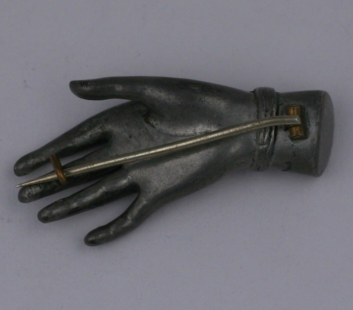 "Victorian Hand Brooch with an beautifully and elegantly modeled 3D hand with flower bracelet. Wonderful for holding a scarf, collar or bouquet. Silvered metal. Late 19th Century. 2"" x 1"". 