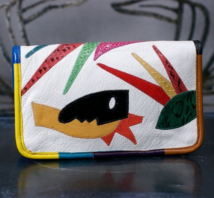 """Colorful clutch bag (with hidden shoulder strap) by Carlos Falchi with Matisse inspired motifs in vibrant snake appliques on white calf leather body. 9"""" x 6"""" x 2"""". 1980's USA. Excellent condition."""