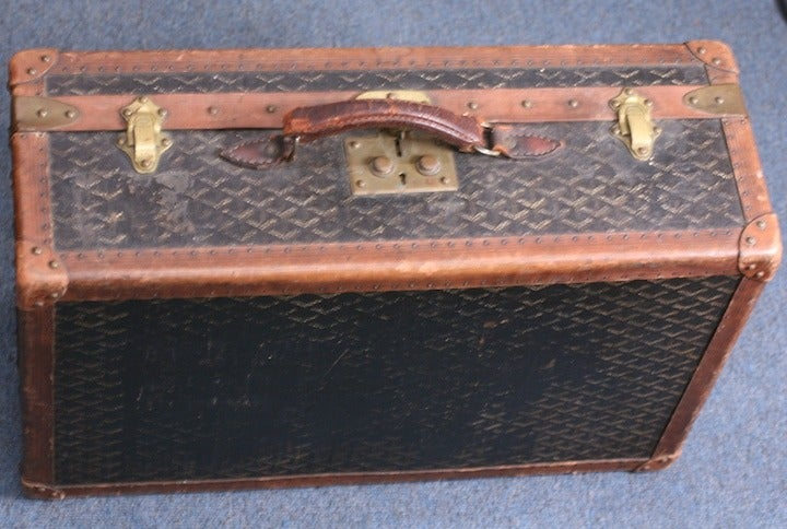 Maison Goyard Suitcase from the early 20th Century. This heritage house is the oldest manufacturer in France. Signature logo textile, leather bound with original signed hardware and lovely patina. 1920's France. Very Good Condition.   24