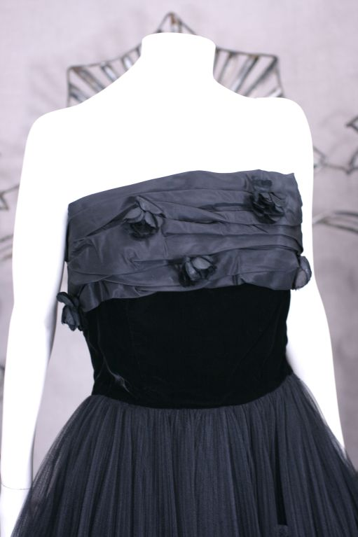 Jacques Fath 50s evening dress of layered pleated tulle, ruched silk taffeta, velvet and silk rosettes. Strapless gown with interior corseted bodice and extremely full multilayered pleated tulle skirt. 4 Layers of tulle with 2 horsehair trimmed