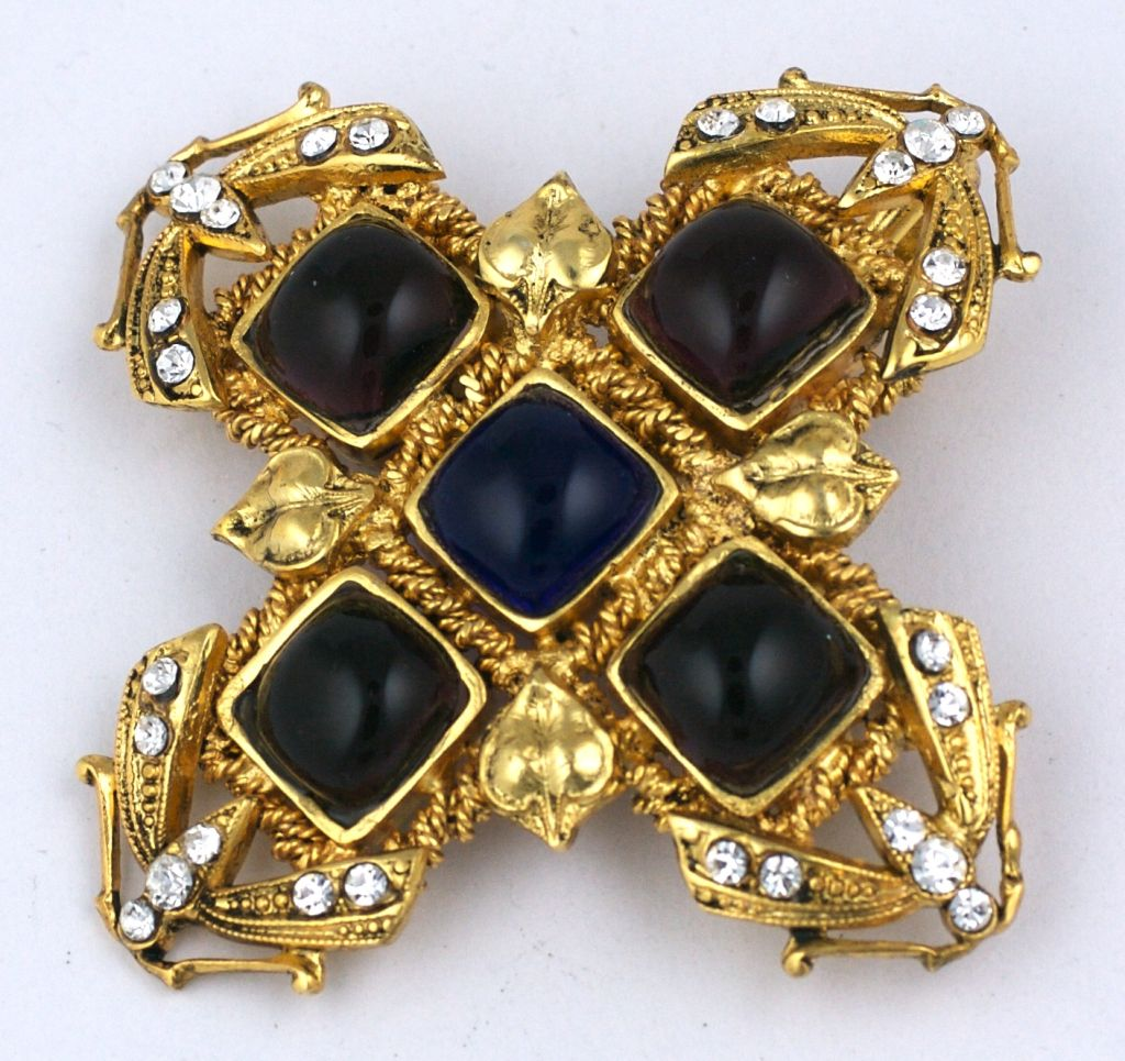 Attractive Chanel brooch made by Gripoix for Chanel circa mid 1980s. Amythest glass cabochons surround a deep sapphire center stone. Ornate gilt baroque setting set with pastes. Additional hook to wear as pendant.<br /> Excellent condition<br
