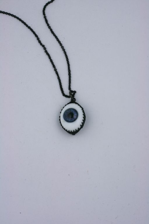 "Rodarte ""Eye"" pendant made for the Japanese Horror (FW08) collection by Mark Walsh Leslie Chin. Antique taxidermy eyes were sourced for this collection which was inspired by the film ""The Grudge/ Ju-on""<br />