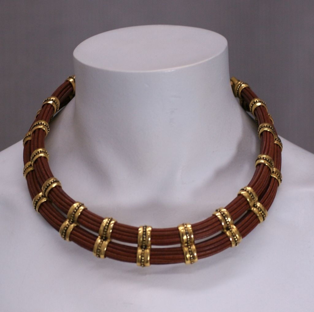 leather cord and gilt metal collar and earrings for sale