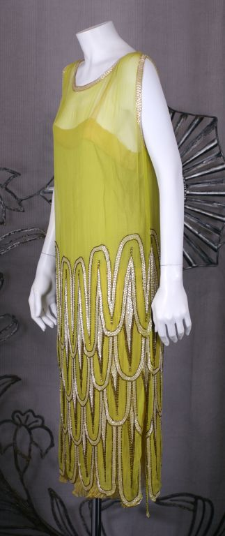 "High style art deco beaded flapper dress from the 1920s France. Lovely and unusual chartreuse colored chiffon with beaded scale ""motifs"" in mother of pearl and antique gold bugles with citrine crystal accents. Pleated silk chiffon and crepe"