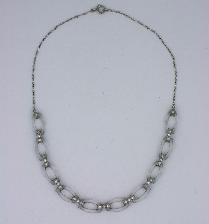 Lovely art deco necklace by Tiffany of carved rock crystal links set in platinum with diamonds. Charming and timeless necklace. Exquisite quality. 1930s USA.