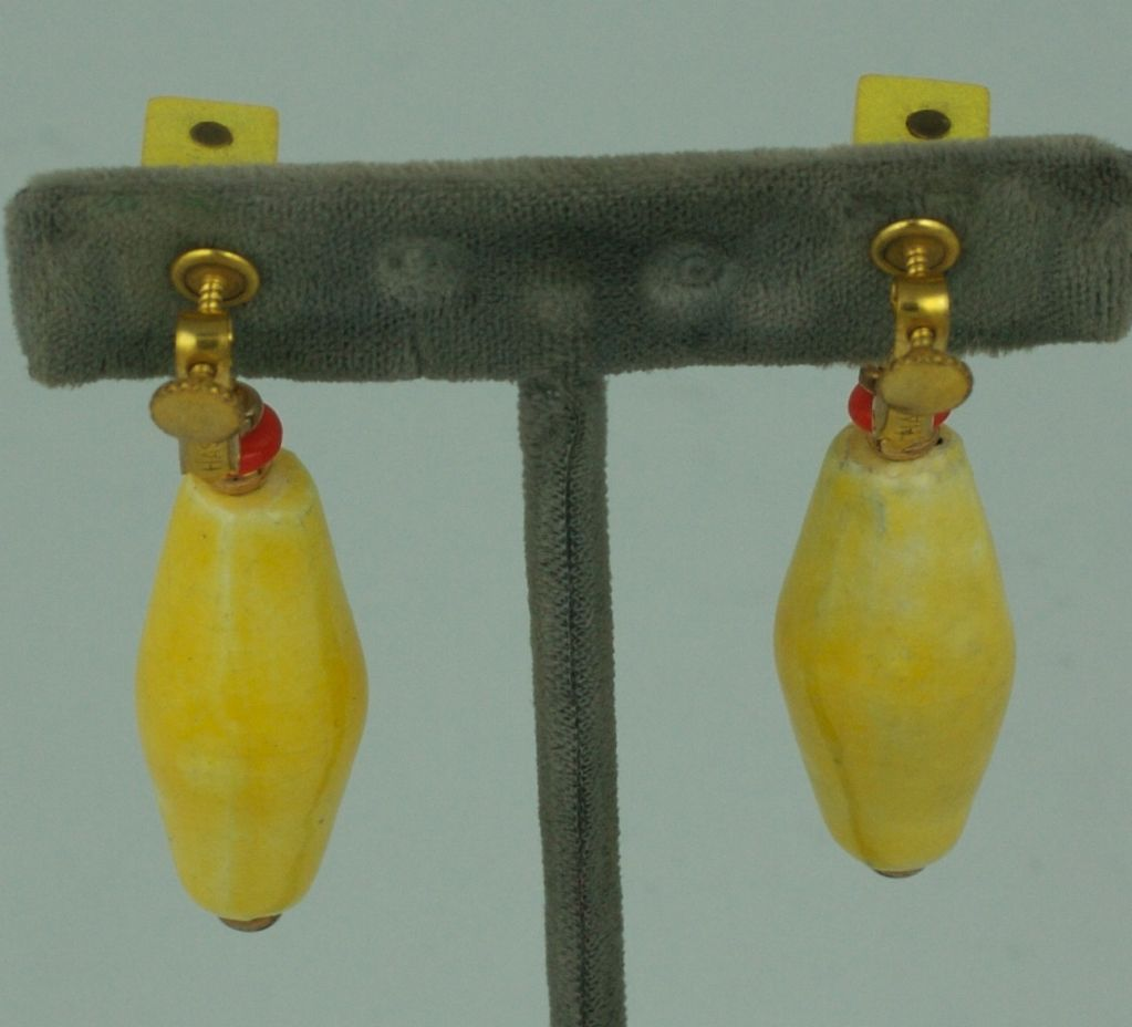 Miriam Haskell rare resort earring of yellow wood , orange glass and hand made yellow glazed ceramic .<br />