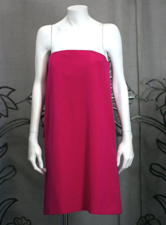 Fuschia heavy ply silk crepe strapless mini by Anne Klein. Clean and simple with dramatic draped bias bow on back. Side zip entry with built in interior bustier.<br />