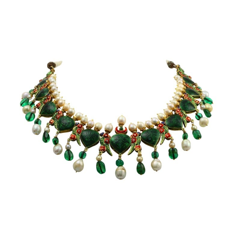 An impressive, vintage, and royal Indian enamel necklace with natural saltwater pearls, old-mine Colombian emerald beads, and large rose cut diamonds. The estimate weight of the diamonds is forty-five to fifty carats. The necklace is presumed to be